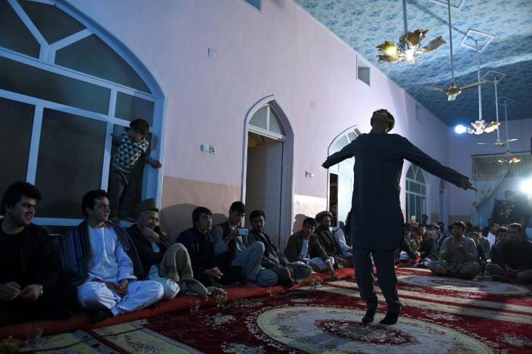 Over-the-top, glitzy weddings are a big deal for Afghans and for the economy in Kabul (AFP Photo/Wakil KOHSAR)