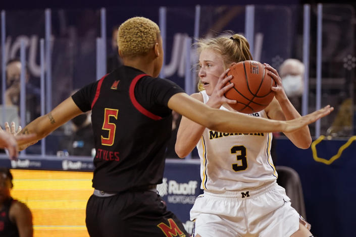 Michigan guard Maddie Nolan (3) looks to pass as Maryland forward Alaysia Styles (5) defends during the first half of an NCAA college basketball game, Thursday, March 4, 2021, in Ann Arbor, Mich. (AP Photo/Carlos Osorio)