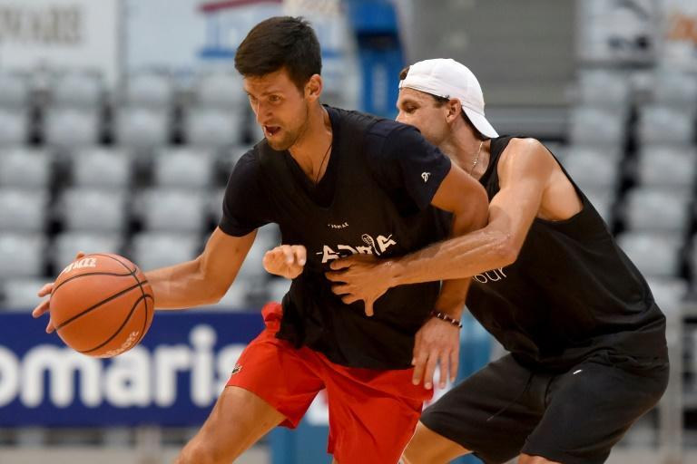 Novak Djokovic (L) played basketball with fellow tennis player Grigor Dimitrov during the event in the Balkans -- both are now positive for coronavirus (AFP Photo/STRINGER)