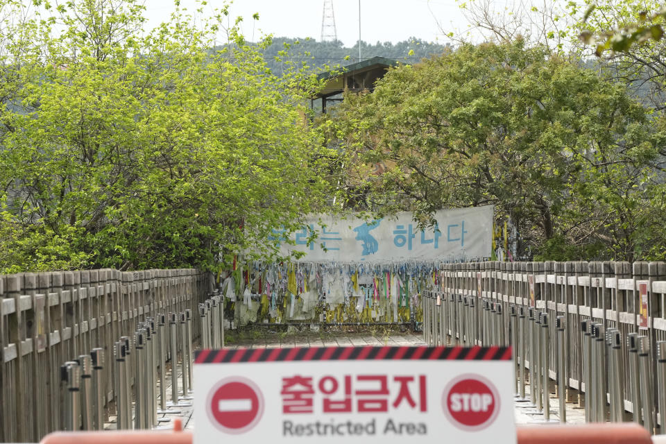 """A banner and ribbons wishing reunification of the two Koreas are displayed on the wire fence at the Imjingak Pavilion in Paju, near the border with North Korea, South Korea, Friday, Sept. 24, 2021. North Korean leader Kim Jong Un's powerful sister, Kim Yo Jong, said Friday, North Korea is willing to resume talks with South Korea if it doesn't provoke the North with hostile policies and double standards.The banner reads: """"We Are One"""". (AP Photo/Ahn Young-joon)"""