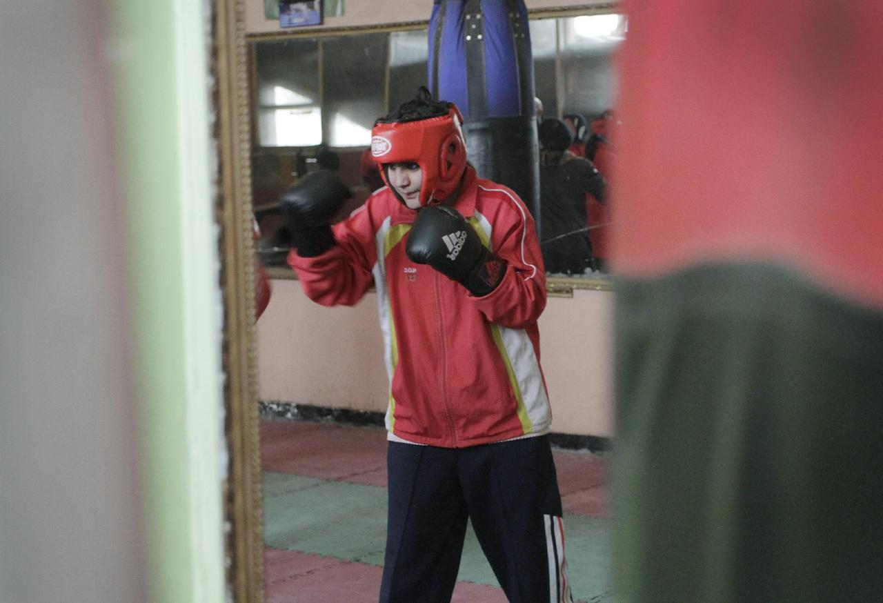In this photo taken Wednesday, Feb. 1, 2012, Sadaf Rahimi, an Afghan woman boxer, practices at a boxing club in Kabul, Afghanistan. As one of the first women to ever box in the Olympics, besides going after a medal in the boxing ring at the London Olympics, Sadaf Rahimi will be taking a few punches in the fight for equal rights for Afghan women. (AP Photo/Musadeq Sadeq)