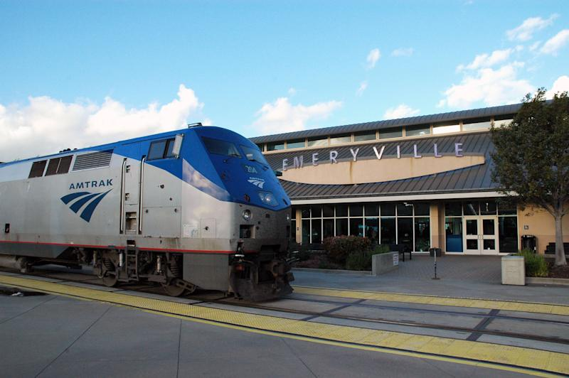 This undated image provided by Amtrak shows the California Zephyr train at the Emeryville Station 11 miles east of San Francisco, en route to Reno, Nev., a 236-mile journey that offers beautiful views as well as history. It crosses the Sierra Nevada mountain range and follows the same course as the historic Transcontinental Railroad, a 19th century engineering feat that bolstered the nation's western expansion. The Zephyr's ultimate destination is Chicago, a 51-hour trip from Emeryville. (AP Photo/Amtrak/Phil Gosney)