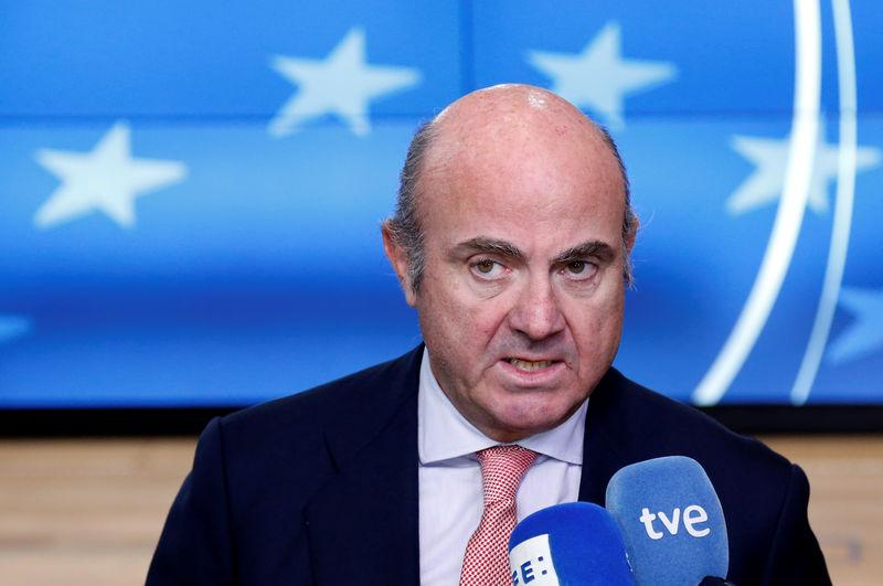 Spain's Economy Minister de Guindos talks to the media during a eurozone finance ministers meeting in Brussels