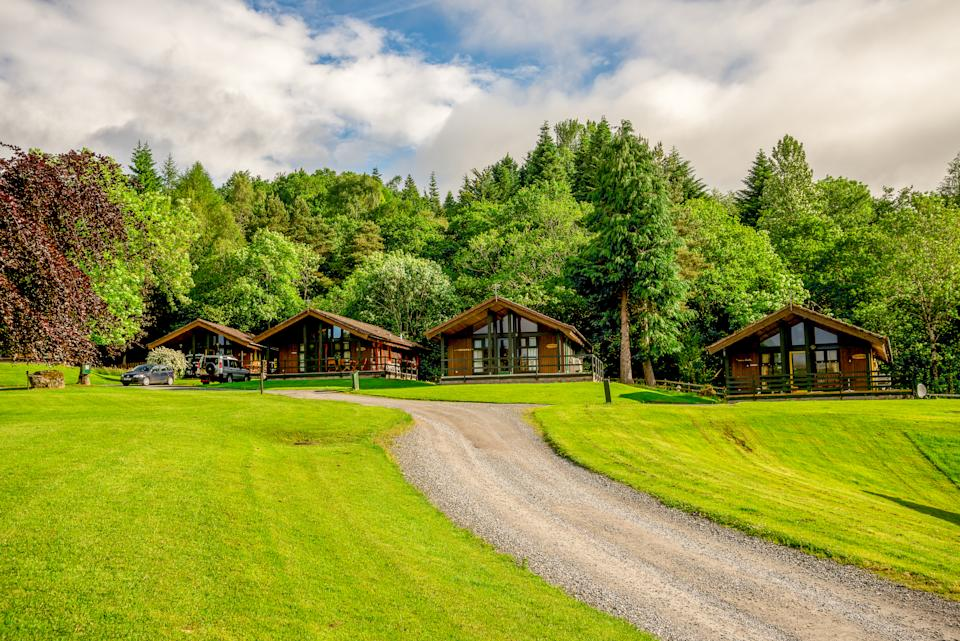 Loch Tay Highland lodges offers upmarket glamping in a serene setting (Getty Images)