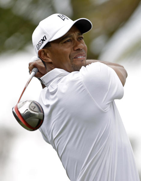 Tiger Woods tees off on the 11th hole during practice at the Cadillac Golf Championship, in Doral, Fla., Wednesday March 6, 2013. (AP Photo/Alan Diaz)