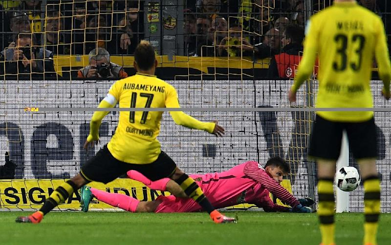 Dortmund's Pierre-Emerick Aubameyang shoots a penalty against Hertha's Norwegian goalkeeper Rune Jarstein during a Bundesliga football match in Dortmund, western Germany on October 14, 2016