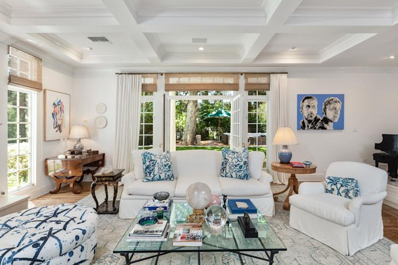 Coffered ceilings, hardwood floors and French doors are among features of the traditional-style house.