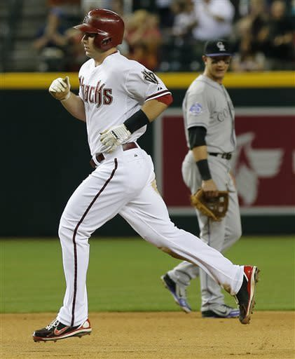 Arizona Diamondbacks' Paul Goldschmidt rounds the bases as Colorado Rockies' Troy Tulowitzki looks on during the fourth inning of a baseball game, Thursday, April 25, 2013, in Phoenix. (AP Photo/Matt York)