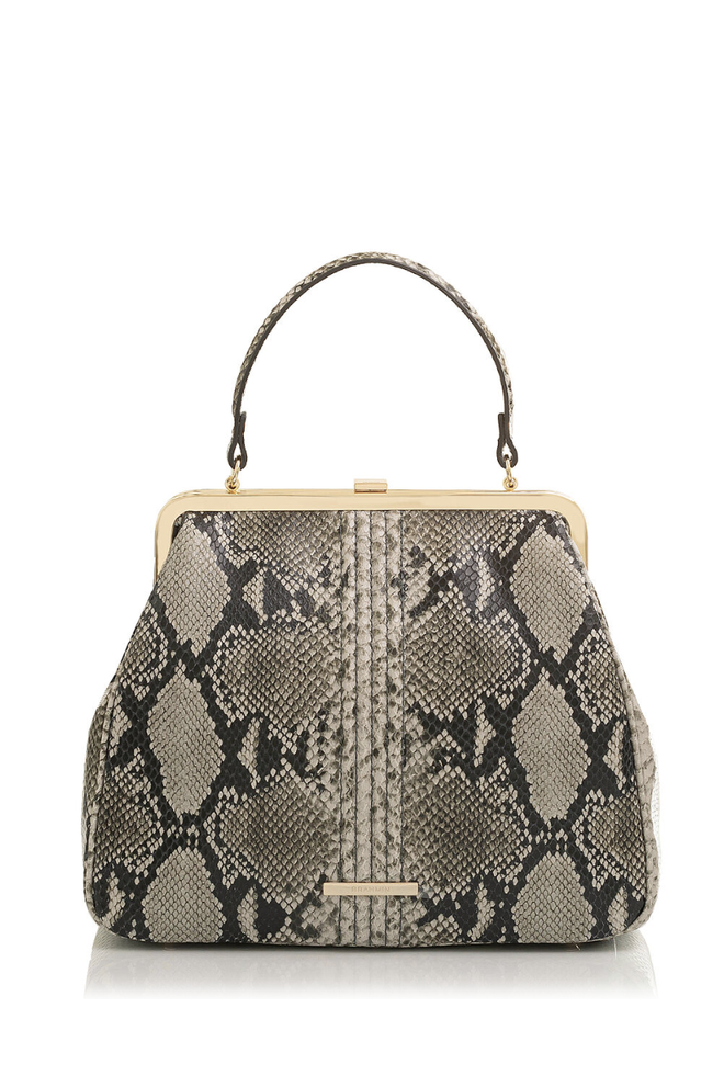 """<p><strong>Brahmin</strong></p><p>brahmin.com</p><p><strong>$385.00</strong></p><p><a href=""""https://go.redirectingat.com?id=74968X1596630&url=https%3A%2F%2Fwww.brahmin.com%2Femmy-stone-felix%2FT03163100584.html%3Fdwvar_T03163100584_color%3DStone&sref=https%3A%2F%2Fwww.marieclaire.com%2Ffashion%2Fg35621230%2Ffall-bag-trends-2021%2F"""" rel=""""nofollow noopener"""" target=""""_blank"""" data-ylk=""""slk:SHOP IT"""" class=""""link rapid-noclick-resp"""">SHOP IT</a></p><p>This python printed leather stunner comes with a strap so you have a hands-free way to wear it as well.</p>"""