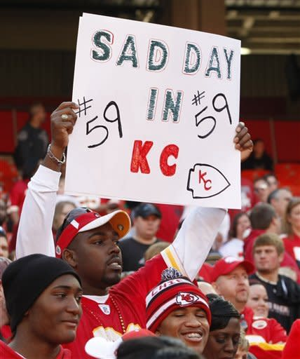 A Kansas City Chiefs fan holds a sign during the first half of an NFL football game against the Carolina Panthers at Arrowhead Stadium in Kansas City, Mo., Sunday, Dec. 2, 2012. (AP Photo/Colin E. Braley)