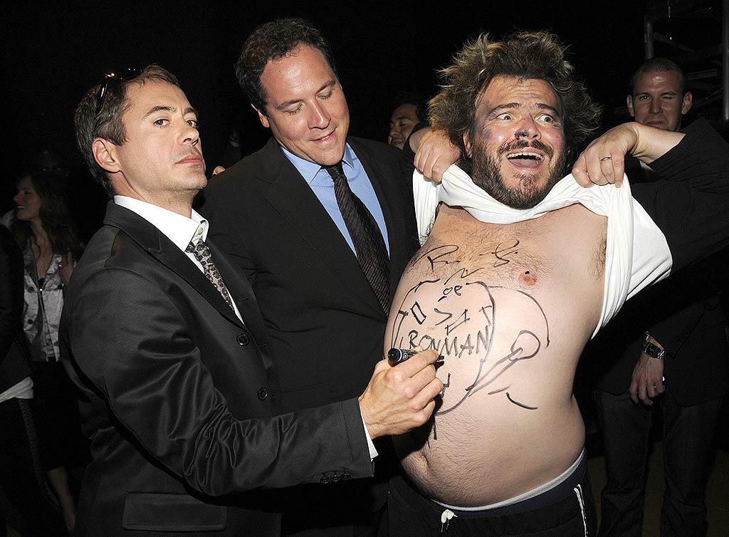 "Robert Downey Jr. (with Jon Favreau) goofed around backstage with his wacky ""Tropic Thunder"" costar Jack Black. Kevin Mazur/<a href=""http://www.wireimage.com"" target=""new"">WireImage.com</a> - June 1, 2008"