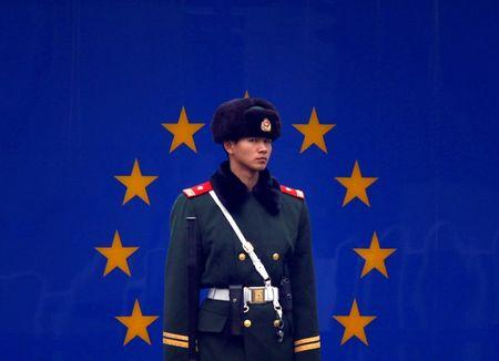 A paramilitary policeman stands guard at the entrance to the European Union embassy in central Beijing
