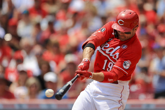 Cincinnati Reds' Joey Votto hits a single during the first inning of a baseball game against the Chicago Cubs in Cincinnati, Sunday, July 4, 2021. (AP Photo/Aaron Doster)