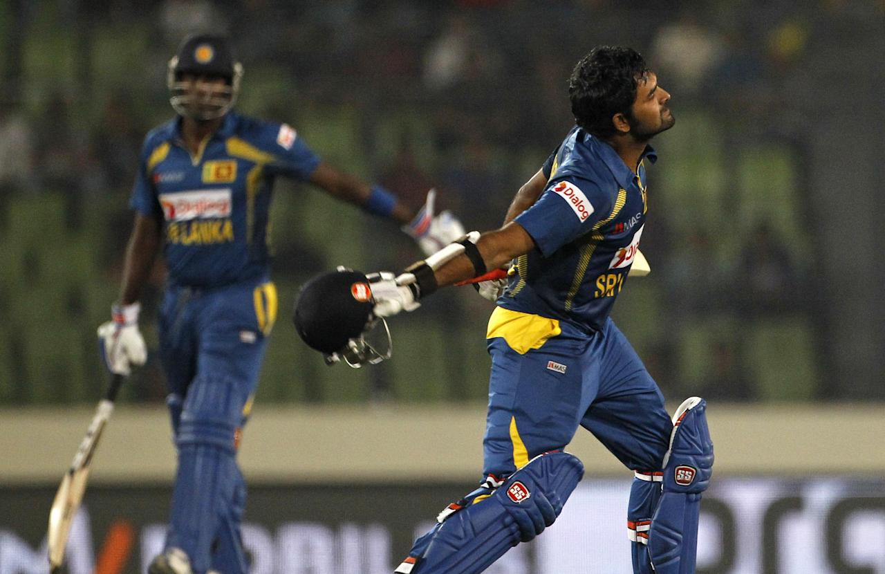Sri Lanka's Lahiru Thirimanne, right, celebrates after scoring a century during the Asia Cup final cricket match between Sri Lanka and Pakistan in Dhaka, Bangladesh, Saturday, March 8, 2014. (AP Photo/A.M. Ahad)