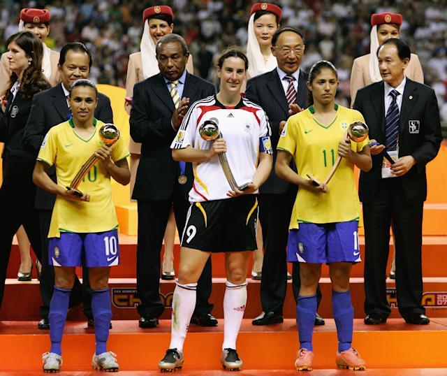 Marta is honored with the adidas golden ball, Birgit Prinz of Germany claims the silver ball and Christiane receives the bronze ball in the 2007 World Cup. (Photo by Christof Koepsel/Bongarts/Getty Images)