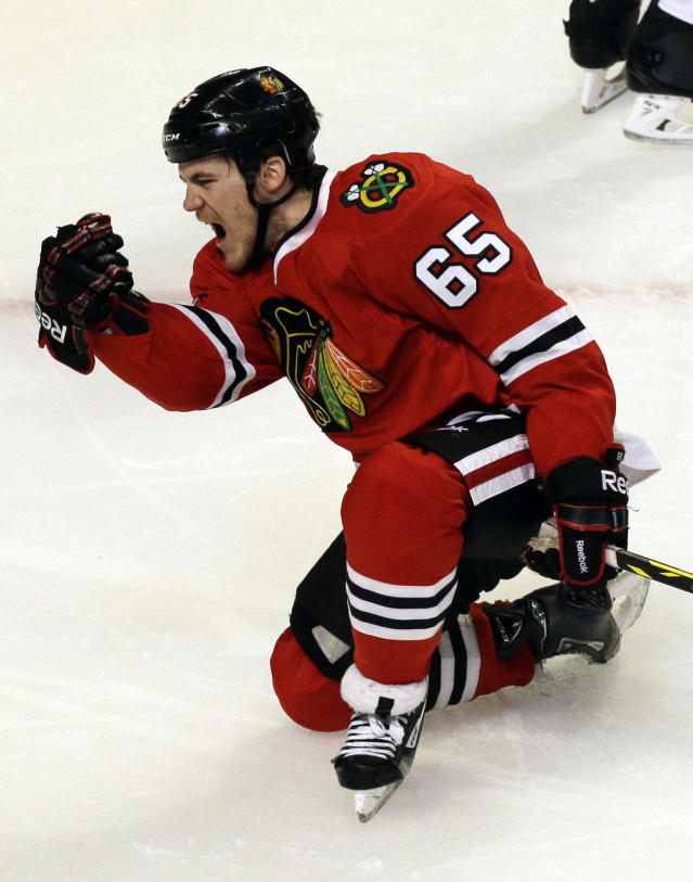 Chicago Blackhawks' Andrew Shaw celebrates after scoring a goal against the St. Louis Blues during the third period in Game 6 of a first-round NHL hockey playoff series in Chicago, Sunday, April 27, 2014. The Blackhawks won 5-1. (AP Photo/Nam Y. Huh)