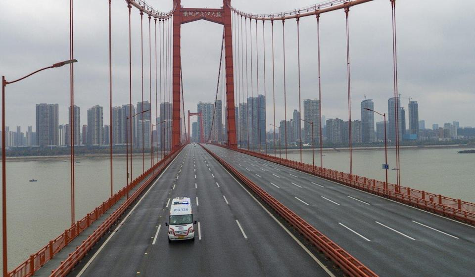 An ambulance drives across a nearly empty bridge in Wuhan in January 2020 when the Hubei province city was under a 76-day lockdown. Photo: AP