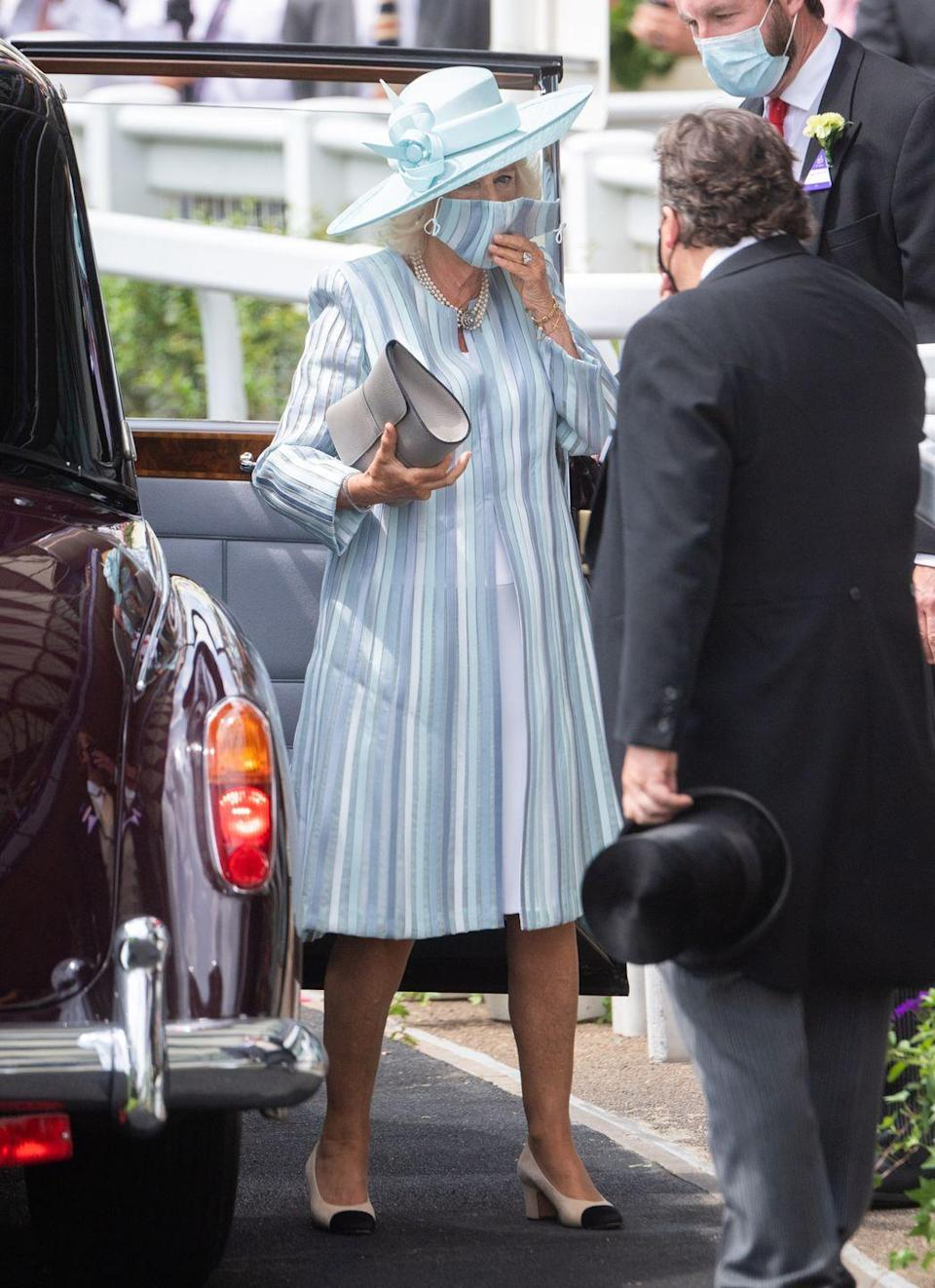 <p>It was all stripes for Camilla at the Royal Ascot. She even matched her mask. </p>