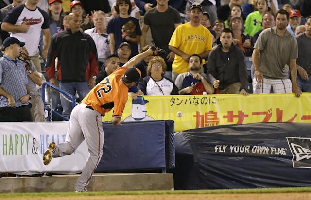 Baltimore Orioles third baseman Cord Phelps misses a foul ball hit by New York Yankees' Carlos Beltran during the third inning of an exhibition baseball game Tuesday, March 4, 2014, in Tampa, Fla. (AP Photo/Charlie Neibergall)