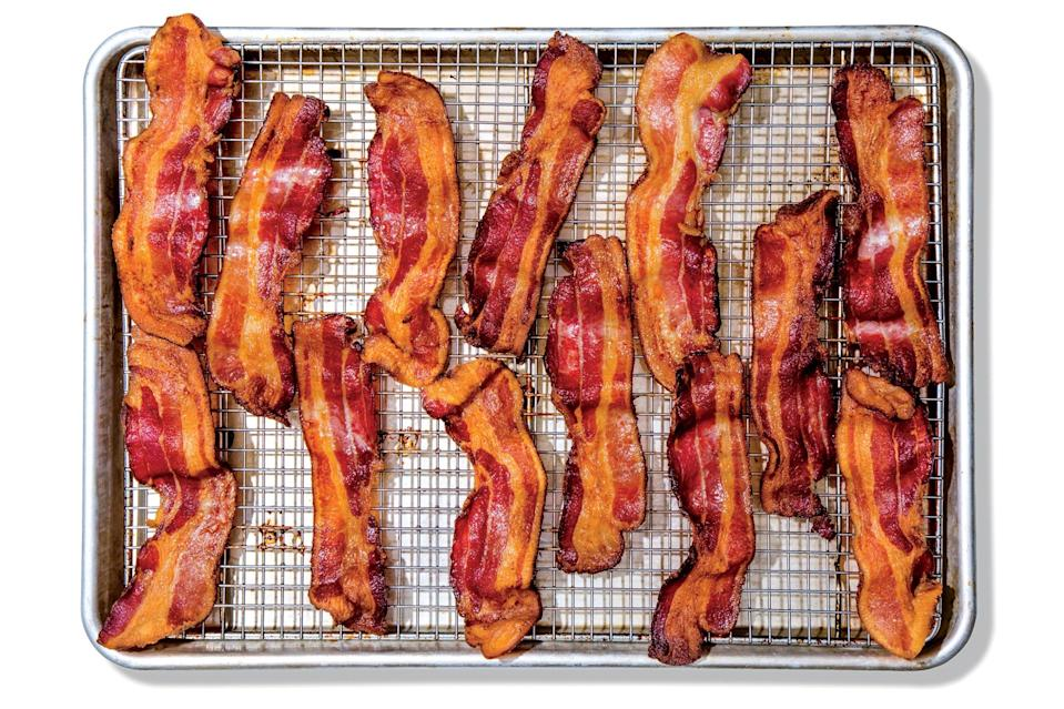 """Go plain or coat your bacon with either a brown sugar–chile rub or a maple-mustard glaze for hands-off cafe-brunch-worthy bacon strips. <a href=""""https://www.epicurious.com/recipes/food/views/bacon-for-a-crowd?mbid=synd_yahoo_rss"""" rel=""""nofollow noopener"""" target=""""_blank"""" data-ylk=""""slk:See recipe."""" class=""""link rapid-noclick-resp"""">See recipe.</a>"""