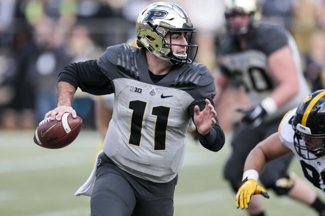 FILE - In this Saturday, Nov. 3, 2018, file photo, Purdue quarterback David Blough (11) runs with the ball in the first half of an NCAA college football game against Iowa in West Lafayette, Ind. Purdue needs one more win to become bowl eligible, but the Boilermakers are chasing more than that, still with an outside chance at winning the Big Ten West Division, where Minnesota sits at the bottom thanks to a reeling defense. (AP Photo/AJ Mast, File)