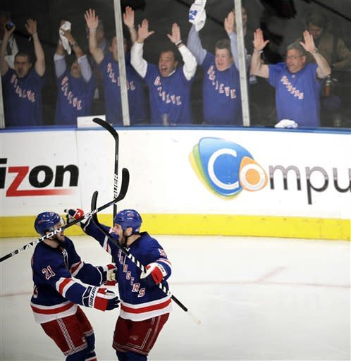 New York Rangers' Dan Girardi (5) celebrates his goal with Derek Stepan (21) during the third period of Game 1 of their NHL hockey Stanley Cup Eastern Conference final playoff series against the New Jersey Devils, Monday, May 14, 2012, at New York's Madison Square Garden. (AP Photo/Julio Cortez)