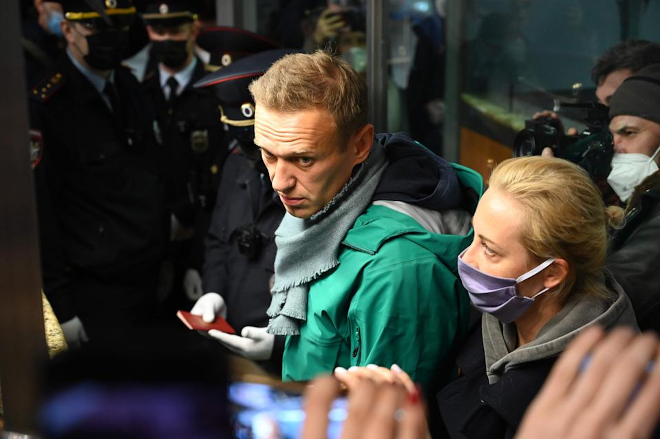Alexei Navalny and his wife Yulia at the passport control point at Moscow's Sheremetyevo airport on January 17AFP via Getty Images