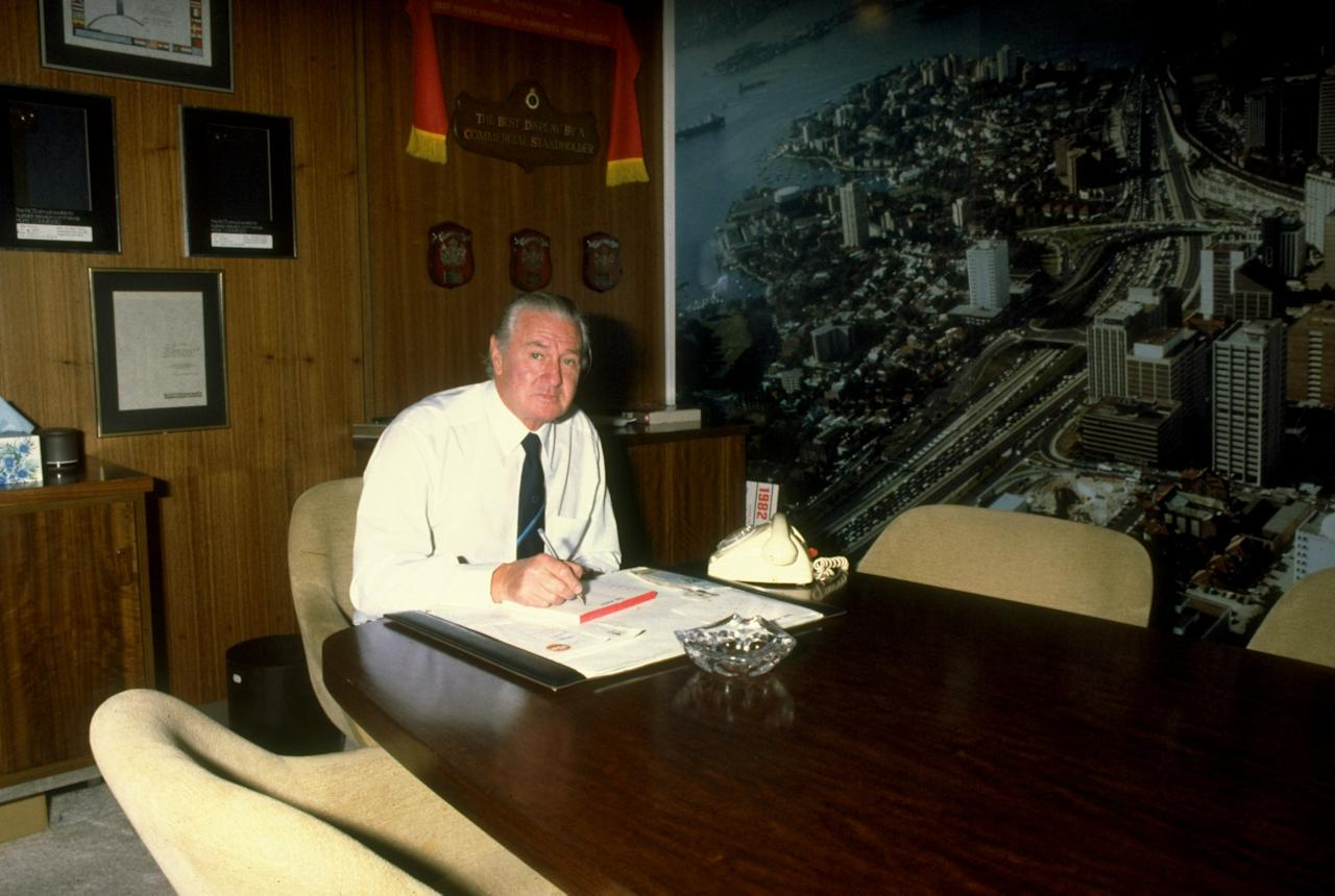 Undated:  Ex Australian player Keith Miller works in his office in Australia. \ Mandatory Credit: Allsport UK /Allsport