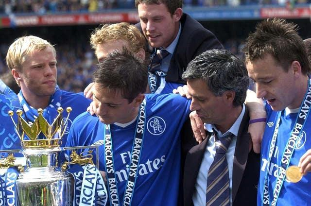 Jose Mourinho, centre right, and Frank Lampard, centre left, celebrate with the Premier League trophy in 2005