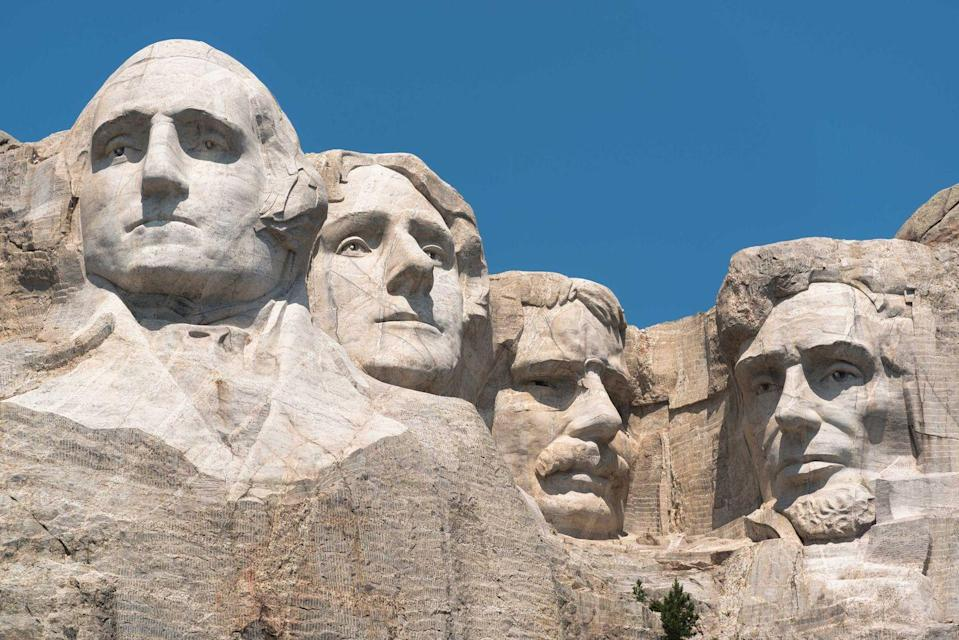 """<p><strong>Mount Rushmore </strong></p><p><a href=""""https://www.nps.gov/moru/index.htm"""" rel=""""nofollow noopener"""" target=""""_blank"""" data-ylk=""""slk:Mount Rushmore National Memorial"""" class=""""link rapid-noclick-resp"""">Mount Rushmore National Memorial</a> in Keystone, South Dakota, should be on everyone's bucket list. Featuring 60 foot tall heads of our Presidents George Washington, Thomas Jefferson, Theodore Roosevelt, and Abraham Lincoln, it's a sight you need to see at least once in your lifetime.</p>"""