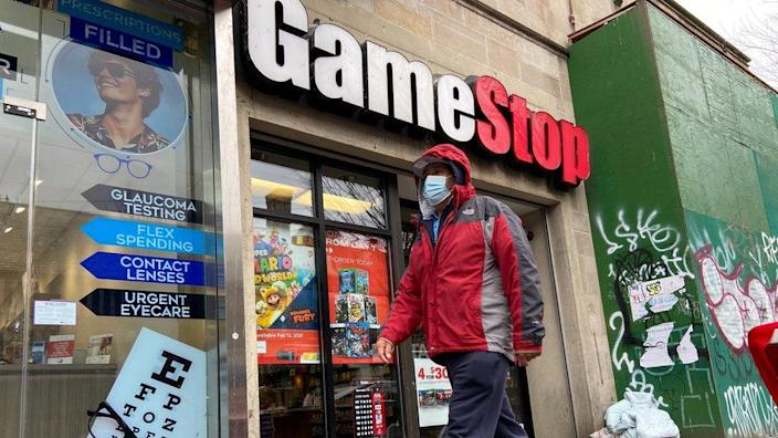 A man walks in front of a GameStop store in the Jackson Heights neighborhood of New York City, New York, U.S. January 27, 2021. Picture taken January 27, 2021