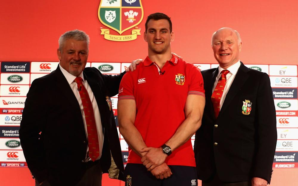 Captain Sam Warburton poses for the cameras flanked by Warren Gatland and John Spencer  - Credit: Getty Images