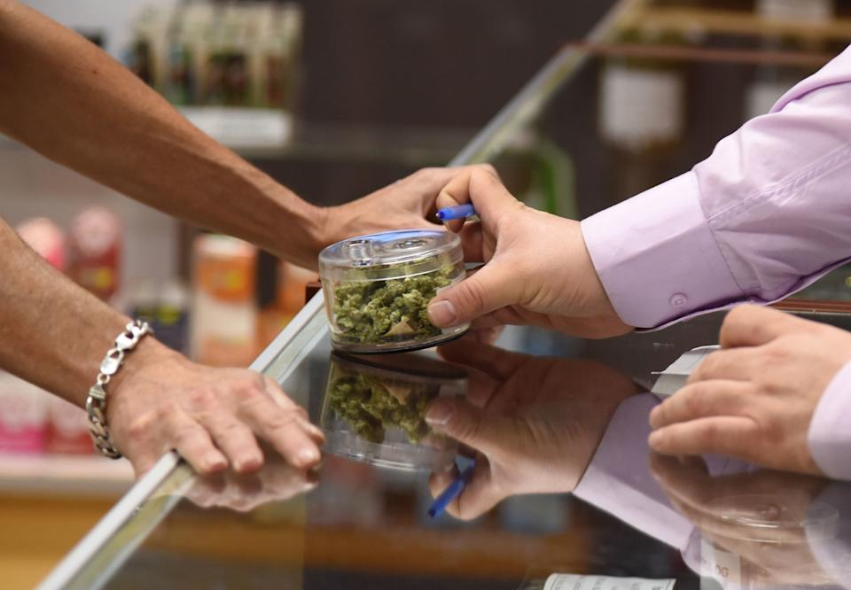"""Playing with cannabis while chatting with customers was definitely unlike any other day at an office I've ever experienced."" (Photo: ROBYN BECK via Getty Images)"