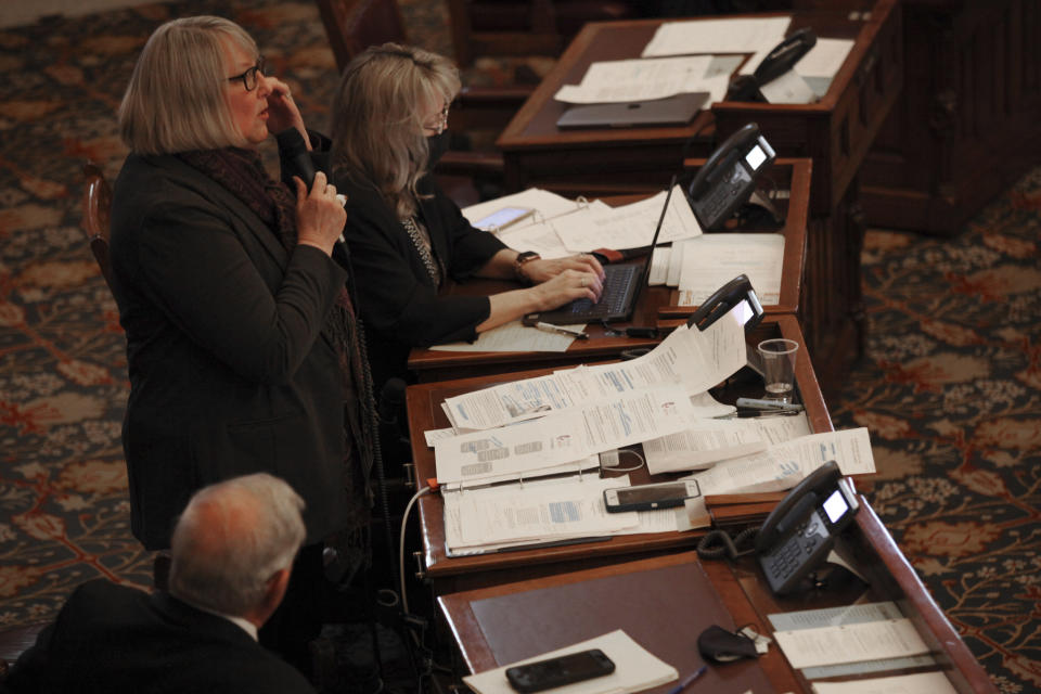 Kansas state Sen. Molly Baumgardner, R-Louisville, speaks in favor of a proposed anti-abortion amendment to the state constitution during a Senate debate, Thursday, Jan. 28, 2021, at the Statehouse in Topeka, Kan. The proposed amendment would not ban abortion, but it would allow the Legislature to enact a ban if the U.S. Supreme Court overturns its landmark 1973 Roe v. Wade decision protecting abortion rights. (AP Photo/John Hanna)