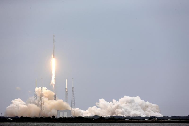 A SpaceX rocket Dargon cargo ship lifts off from launch complex 40 at the Cape Canaveral Air Force Station in Cape Canaveral, Fla., Friday, April 18, 2014. The rocket will deliver research equipment, food and other supplies to the International Space Station. (AP Photo/John Raoux)