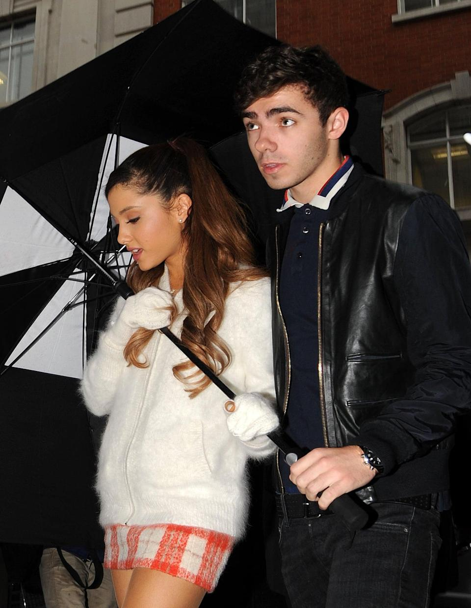 """<p><a href=""""https://www.usmagazine.com/celebrity-news/news/ariana-grande-and-nathan-sykes-confirm-their-coupledom-2013259/"""" class=""""link rapid-noclick-resp"""" rel=""""nofollow noopener"""" target=""""_blank"""" data-ylk=""""slk:Ariana moved on with The Wanted singer"""">Ariana moved on with The Wanted singer</a> shortly after, and the two dated for four months in 2013. The couple even collaborated on Ariana's song """"Almost Is Never Enough."""" It's unclear what went wrong, but in February 2014, Ariana confirmed in an interview that <a href=""""https://www.j-14.com/posts/ariana-grande-and-nathan-sykes-breakup-rumors-confirmed-19433/photos/ariana-grande-and-nathan-sykes-cute-moments-1-17694"""" class=""""link rapid-noclick-resp"""" rel=""""nofollow noopener"""" target=""""_blank"""" data-ylk=""""slk:they had split"""">they had split</a>. """"We broke up a little while ago, but he's a really good friend,"""" Ariana said. """"He's so talented. I am so glad to have met him and have a friend like him in my life. He's an amazing person. It was very civil. It was mutual."""" In 2016, they collaborated again, only this time it was for <a href=""""https://www.youtube.com/watch?v=7uJ4kJiMUAc"""" class=""""link rapid-noclick-resp"""" rel=""""nofollow noopener"""" target=""""_blank"""" data-ylk=""""slk:Nathan's song"""">Nathan's song</a> """"Over and Over Again.""""</p>"""