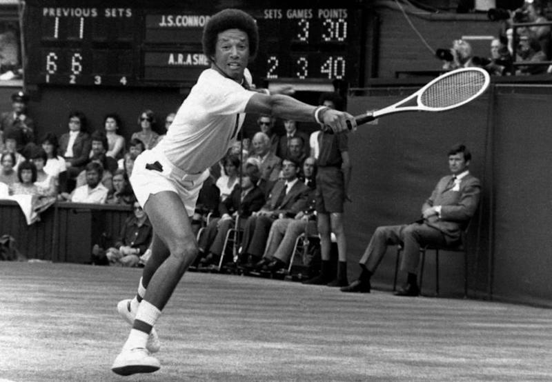 Arthur Ashe n action against Jimmy Connors at Wimbledon in 1975.