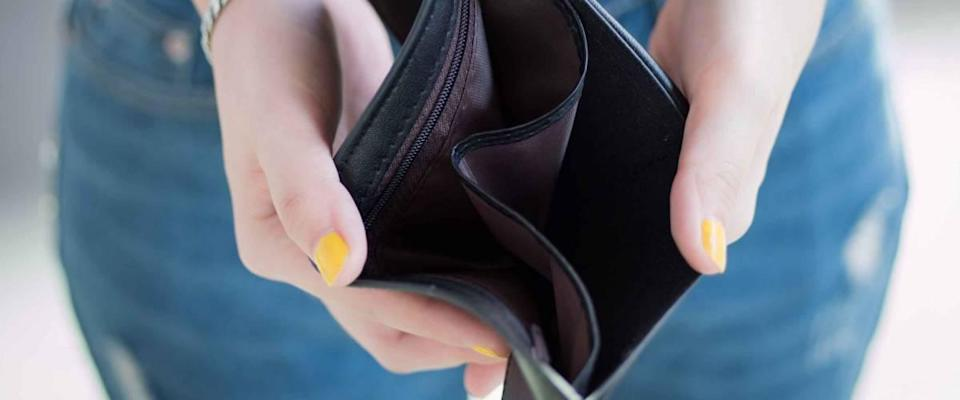 close up of woman showing empty wallet