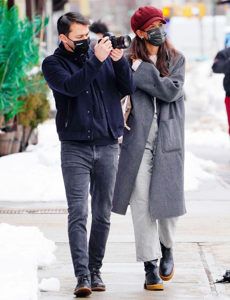 <p>Katie Holmes and boyfriend Emilio Vitolo Jr. go for a walk in snowy N.Y.C. and snap photos along the way on Wednesday. </p>