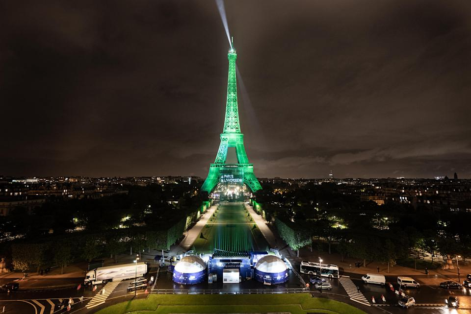 """For the first time in its history, the Eiffel Tower was illuminated with a green light and lit with certified """"renewable"""" hydrogen."""