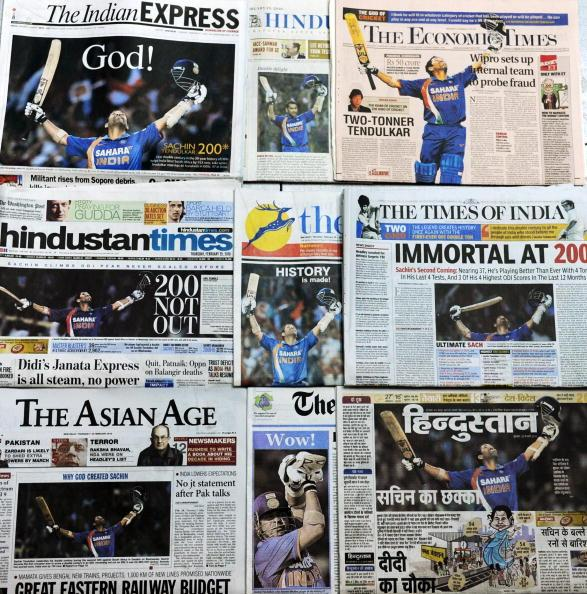 In this photograph taken in New Delhi of combined Indian national newspaper frontpages on February 25, 2010, Indian cricketer Sachin Tendulkar is shown celebrating his record breaking double century (200 runs) in the second One Day International (ODI) match against South Africa in Gwalior on February 24, 2010. Tendulkar's landmark dominated the front pages of leading newspapers, even overshadowing India-Pakistan diplomatic talks. AFP PHOTO/STR (Photo credit should read STR/AFP/Getty Images)