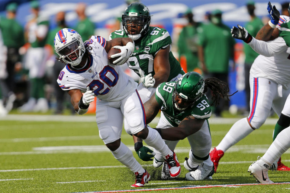 Buffalo Bills running back Zack Moss (20) is tackled by New York Jets nose tackle Steve McLendon (99) during the second half of an NFL football game in Orchard Park, N.Y., Sunday, Sept. 13, 2020. (AP Photo/Jeffrey T. Barnes)