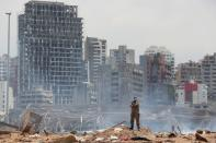 FILE PHOTO: A soldier stands at the devastated site of the explosion at the port of Beirut