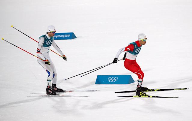 Nordic Combined Events - Pyeongchang 2018 Winter Olympics - Men's Individual 10 km Final - Alpensia Cross-Country Skiing Centre - Pyeongchang, South Korea - February 20, 2018 - Jarl Magnus Riiber of Norway and Akito Watabe of Japan in action. REUTERS/Carlos Barria