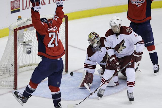 Washington Capitals right wing Troy Brouwer (20) celebrates his goal as Phoenix Coyotes goalie Mike Smith (41) and Coyotes' Zbynek Michalek (4) react during the third period of an NHL hockey game, Saturday, March 8, 2014, in Washington. The Capitals won 3-2. (AP Photo/Carolyn Kaster)
