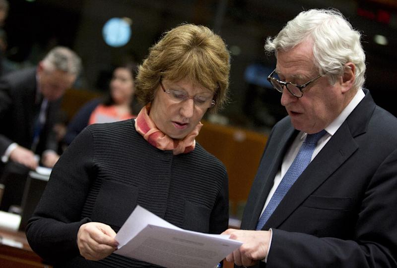 Executive Secretary General of the EU External Action Service Pierre Vimont, right, shows a paper to EU Foreign Policy chief Catherine Ashton during an emergency meeting of EU foreign ministers at the EU Council building in Brussels on Monday, March 3, 2014. EU foreign ministers meet in emergency session on Monday to discuss the ongoing crisis in Ukraine. (AP Photo/Virginia Mayo)