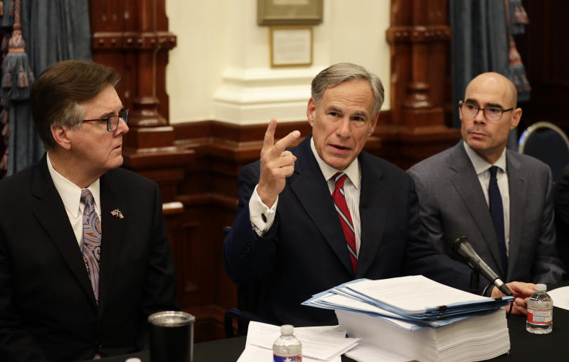 Texas Gov. Greg Abbott, center with Speaker of the House Dennis Bonnen, right, and Lt. Governor Dan Patrick, left, makes opening statements during a round table discussion, Thursday, Aug. 22, 2019, in Austin, Texas. Abbott is meeting in Austin with officials from Google, Twitter and Facebook as well as officials from the FBI and state lawmakers to discuss ways of combatting extremism in light of the recent mass shooting in El Paso that reportedly targeted Mexicans. (AP Photo/Eric Gay)