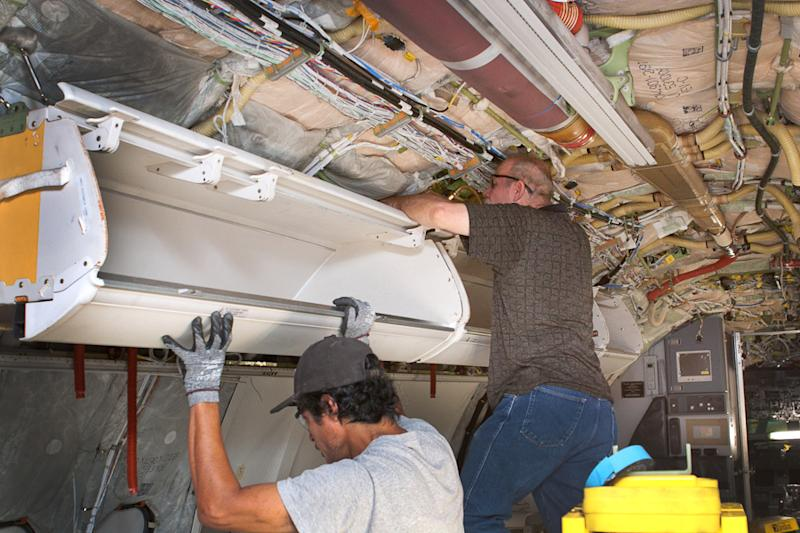 Overhead bins get bigger to fit more carry-on bags