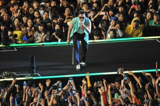 """South Korean singer Park Jae-Sang, also known as Psy, performs during his free concert in Seoul on October 4, 2012. Psy brought his hit """"Gangnam Style"""" home Thursday with a raucous free concert in Seoul, capping a month of global chart success that turned the chubby 34-year-old into a national hero"""