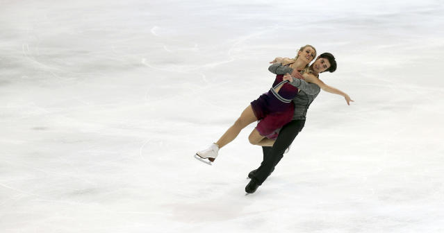 United States' Madison Hubbell and Zachary Donohue perform during the ice dance free dance at the Four Continents figure skating championships in Taipei, Taiwan, Thursday, Jan. 23, 2014. (AP Photo/Chiang Ying-ying)